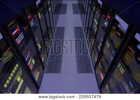 Working data center interior. Concept of hosting, computer cluster, supercomputer, virtual servers, digital cloud or mining crypto currency farm. Top angle view