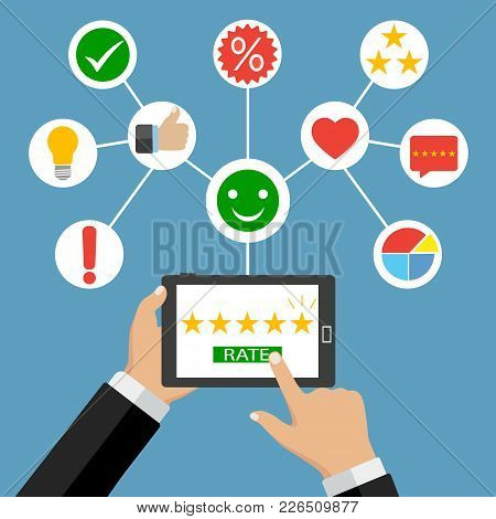 Hands Holding A Tablet Computer With Rating Stars. Rating Stars App With Five Golden Stars.