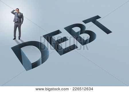 Businessman in debt and borrowing concept
