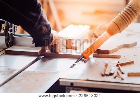 A Carpenter Works On Woodworking The Machine Tool. Toned Image. Carpenter Working On Woodworking Mac
