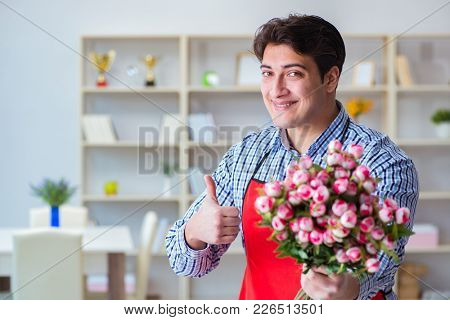 Flower shop assistant offering a bunch of flowers