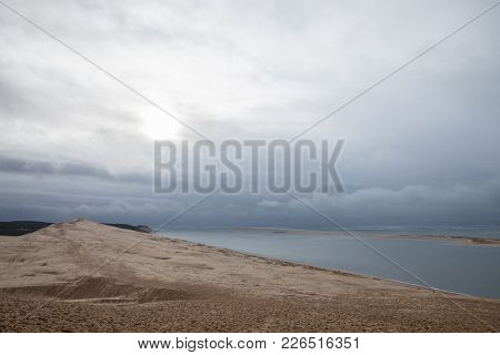 Panorama Of The Pilat Dune (dune Du Pilat) During A Cloudy Afternoon With The Atlantic Ocean In Back