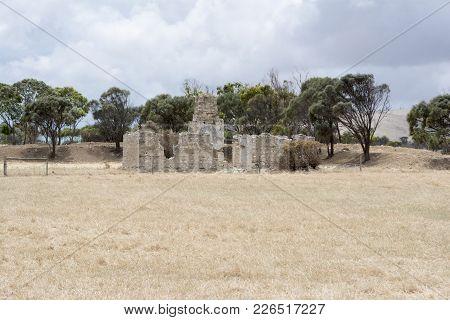 Cape Jervis, South Australia, Australia - December 2, 2017: Old Homestead Ruins In A Random Field.