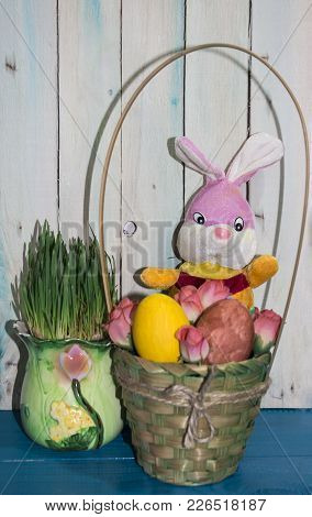 Happy Easter. Colorful Easter Eggs In Wicker Baskets. Easter Bunny. Easter Background With Copyspace