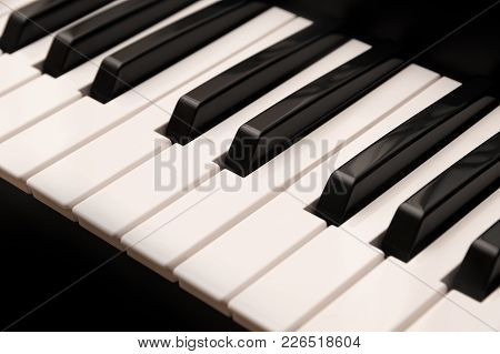 Classic Grand Piano Keyboard With Black And White Keys As A Music Background, Selected Focus, Narrow