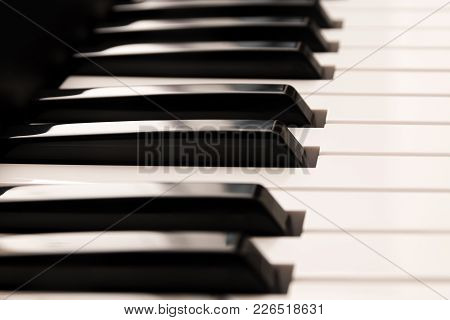 Classic Grand Piano Keyboard, Close Up Of The  Glossy Black And White Keys From The Side, Music Back