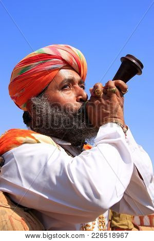 Jaisalmer, India-february 16: Unidentified Men Blows Horn During Desert Festival On February 16, 201