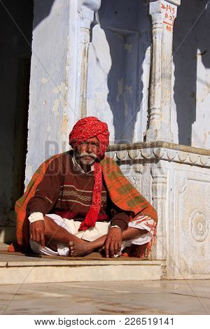 Pushkar, India - February 24: An Unidentified Man Sits In The Street On February 24, 2011 In Pushkar