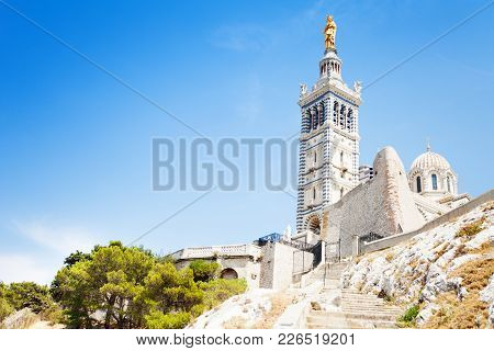 Belfry, Bell Tower And Statue Of The Virgin With Child Of Basilica Notre-dame De La Garde, Marseille