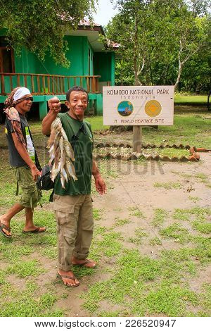 Rinca, Indonesia - March 15: Unidentified Man Stads With Fish On Rinca Island On March 15, 2012 In K