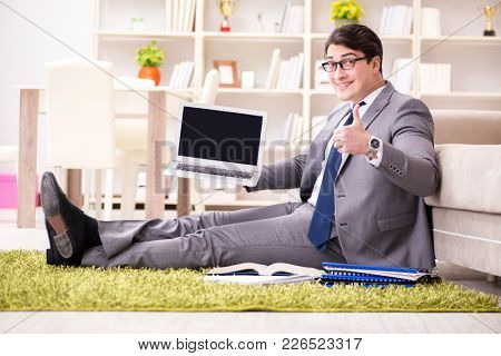 Businessman working on the floor at home