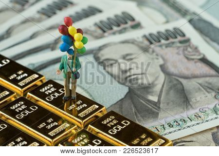 Financial Freedom Or Happy Retirement Concept, Miniature Figure Happy Old Man Holding Balloons Stand