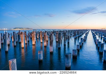 Old Wooden Pylons Of Historic Princes Pier In Port Melbourne At Dusk. Australia. Long Exposure Lands