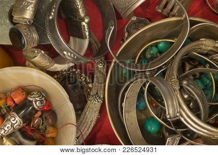 Buddhist Jewelry In An Antique Store: Copper Bracelets With Patterns, Tibetan Talismans, Turquoise B