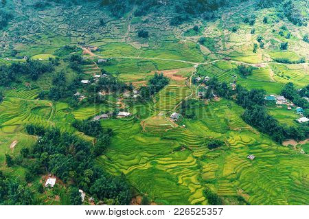 Aerial View Of Green Rice Terraces And Mountain Village. Nature Background. Vietnam