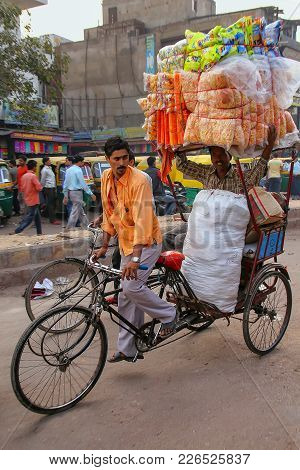 Agra, India - November 10: Unidentified Men Ride Pedicab At Kinari Bazaar On November 10, 2014 In Ag