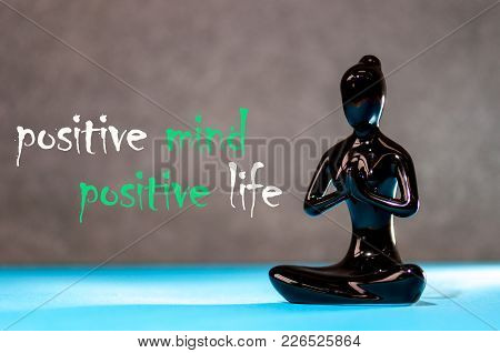 Positive Mind - Positive Life. Figurine Of A Meditating Young Girl. Lifestyle Positive Thoughts Mind