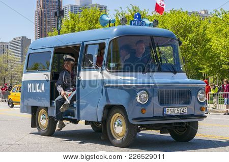 Chicago, Il, United States - May 06, 2017: Peope Riding Inside Of A Polish Police Vehicle During The