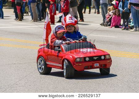 Chicago, Il, United States - May 06, 2017: Young Children Parading In A Toy Car During The Polish Co
