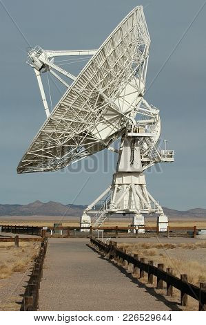 A Huge Radio Antenna At The Very Large Array Facility In New Mexico.