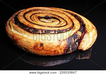 Chocolate Pastry Swirl On Black Reflective Studio Background. Isolated Black Shiny Mirror Mirrored B