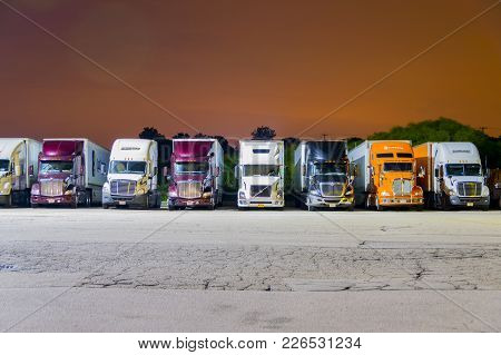 Franksville, Wi, United States; August 6, 2017: Tractor-trailer Trucks Parked For Night At A Local P