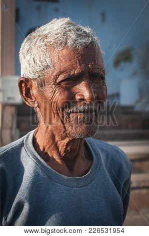 Pushkar, India - 16th February 2015 : Portrait Of An Indian Elder With Grey Hair.