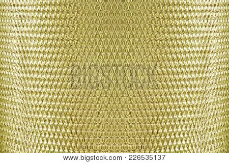 metal mesh grate gold, yellow background