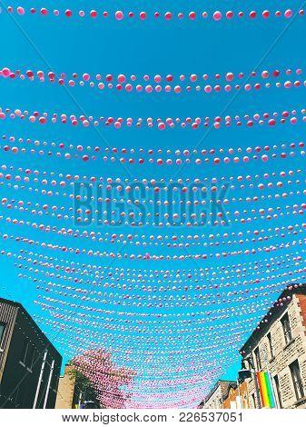 Joyful Street In Gay Neighborhood Decorated With Pink Balloons. Annual Summer Installation In Gay Vi