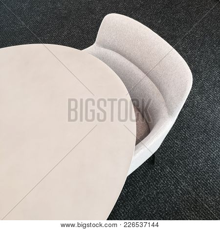 Round Table And Comfortable Fabric Chair. Contemporary Furniture Design.