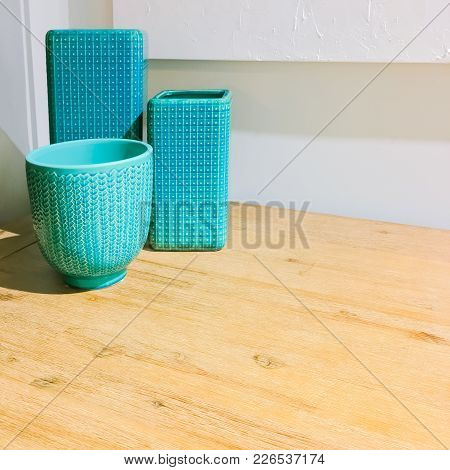 Turquoise Ceramic Vases On A Wooden Table. Contemporary Home Decor.