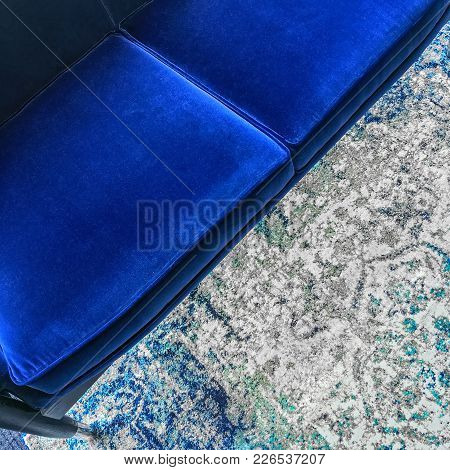Luxurious Blue Velvet Sofa And A Fashionable Rug. Classy Furniture.