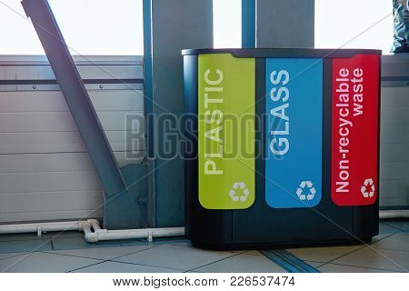 Modern Bins To Collect Plastic, Glass And Non-recyclable Waste. Concept: Garbage Collection Manageme