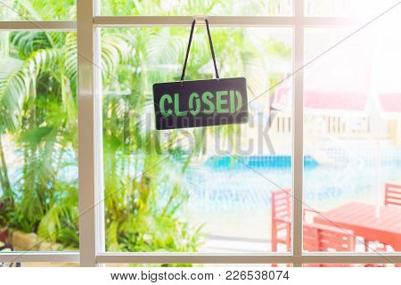 The «closed» Label Hangs On The Window. Sunny Summer Day, The Door With A Window.