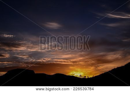 Sun Behind A Mountain Silhouette In Gran Canaria Spain
