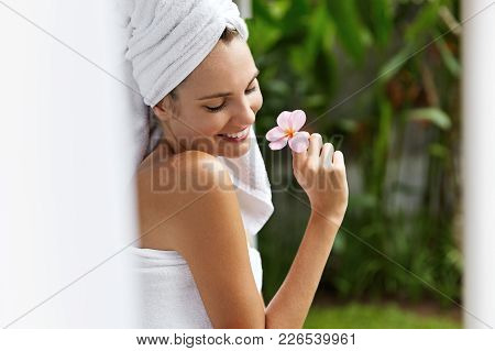 Relief After Hard Working Stressful Day. Beautiful Woman Wrapped In White Towels, Feels Pleased Afte