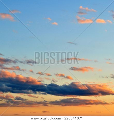 The Sky At Dusk In The Summertime Showing A Colorful Sky And Clouds.