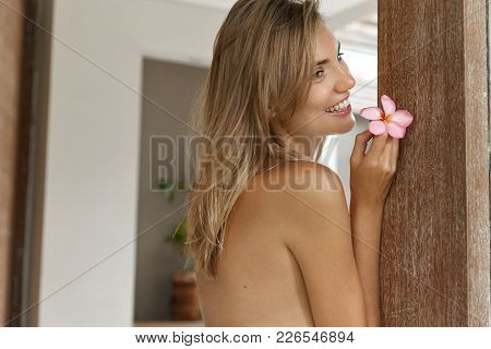 Nude Pretty Sexy Woman Stands Back At Camera, Demonstrates Her Perfect Slender Body, Has Pleasant Sm
