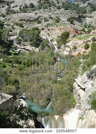 Waterfall In Woods Near El Chorro, Andalusia, Spain On The Path Of Caminito Del Rey, The Kings Walkw
