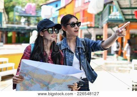 Travel And Relaxing Concepts, Tourists Are Taking Photos In The City. Asian Girls Are Happily Travel