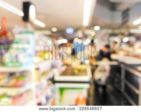 Cashier And Customer At Checkout Counter In Supermarket Background