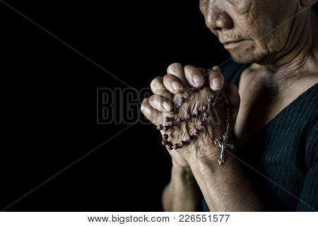 Close Up Of Old Hands Praying On Black Background, Concept Hope And Worship