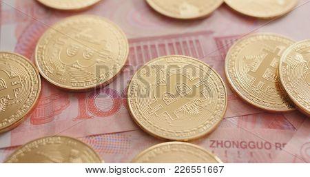 RMB banknote and bitcoin