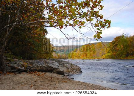 A River In New Hampshire During The Autumn Time On A Sunny Day.