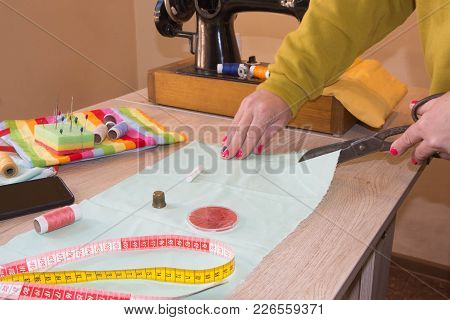 Sewing Machine.sewing Process In The Phase Of Overstitching. Dressmaker Work On The Sewing Machine.t