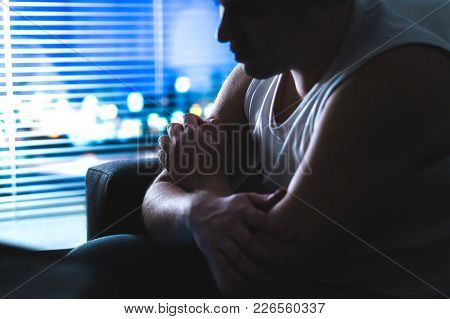 Thoughtful, Pensive And Contemplating Man Thinking In Dark Home At Night By The Window. Emotional An