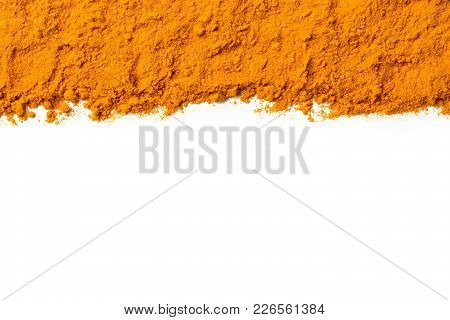 Curcuma Ground Powder Isolated On White Background. A Band Or Streak Of Curcuma Is Located On The To