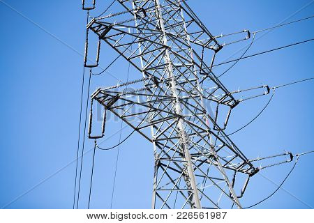 Picture Of Transmission Line Tower On Bright Blue Sky