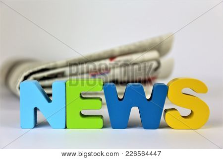An Concept Image Of A Newspaper With The Word News