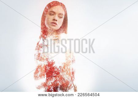 Nature. Beautiful Young Pleasant Woman Feeling Calm While Standing Against The Natural Background An